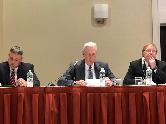 A panel of Nuclear Regulatory Commission officials, left to right: Justin Poole, Steve Hammann, Bruce Watson, hears public comment at a Three Mile Island decommissioning hearing Tuesday, July 23.