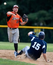 Stoverstown shortstop Levi Krause makes the throw to first to complete the double play as Dan Rhodes of Glen Rock slides into the bag, Tuesday, July 23, 2019. John A. Pavoncello photo