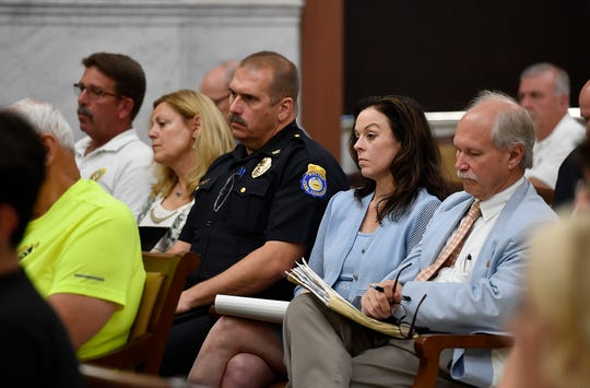 Several police chiefs, including Guy Hettinger of Penn Township, center, attend a public meeting for York County Commissioners to hear a report on the audit of the 911 Center by IXP Corp. Wednesday, July 24, 2019.