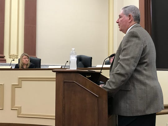 IXP President and COO Larry Consalvos delivers the results of the audit his company conducted on York County 911 to county commissioners on Wednesday.