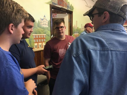 These four teen historians go over logistics - yes, scheduling and such - concerning the Red Lion Train Station Museum. The four young historians, from left, are Nate Heffner, Tristan Mundis, Tate Lehman and Nathan Filak.