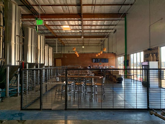 The taproom at the new Lead Dog Brewing Co. in Sparks has 60 seats, 30 handles and a bar topped with acid-washed copper.