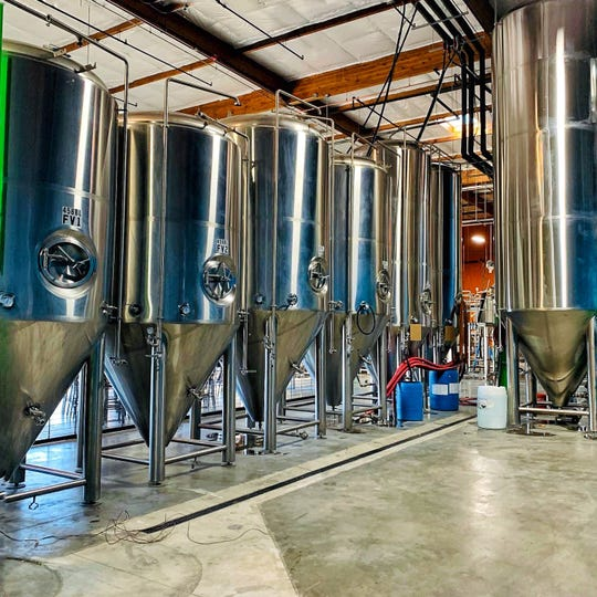 Gleaming fermenters at the new Lead Dog Brewing taproom and production facility in Sparks.