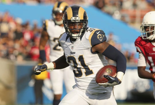 Safety Maurice Alexander of the Los Angeles Rams returns an interception against the Arizona Cardinals in the second quarter at Los Angeles Memorial Coliseum on January 1, 2017. Alexander signed with the Buffalo Bills in the offseason.