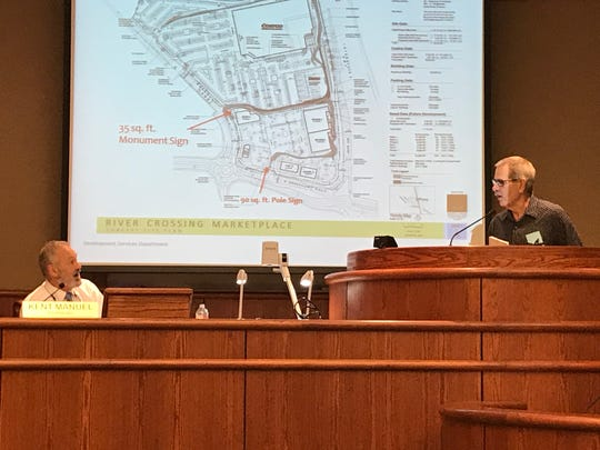 Tom Mancuso, right, of the Bonnyview Bechelli Coalition, asks city planner Kent Manuel a question during Tuesday's meeting.