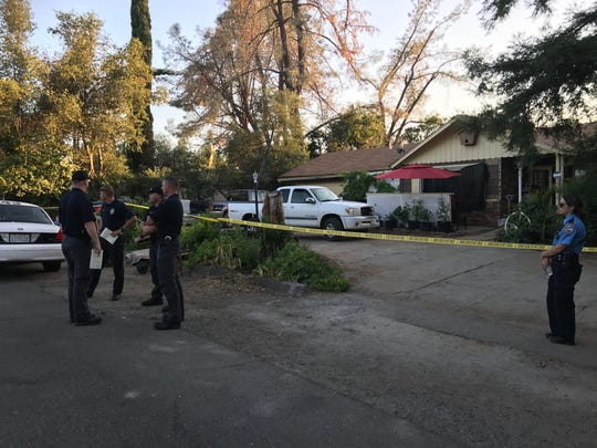 Redding police on July 23, 2019 stand outside a home in the 3700 block of Bechelli Lane.