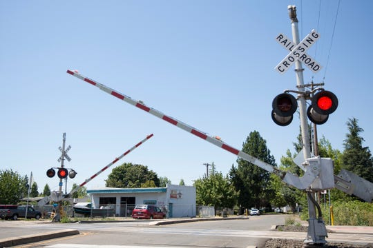 Railroad crossing gates come down on Sunnyview Road NE, at one of the most dangerous railroad crossings in Marion County, in Salem on July 22, 2019.