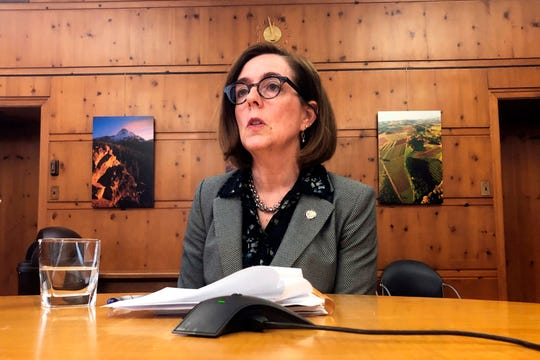 Oregon Gov. Kate Brown speaks with the media at the Capitol in Salem, July 1, 2019. Legislation allowing certain terminally ill patients to have quicker access to life-ending medications under the state's first-in-the-nation assisted suicide law has been signed into law.