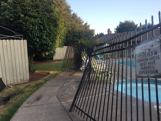A suspect fleeing deputies crashed into an apartment complex fence Tuesday evening.