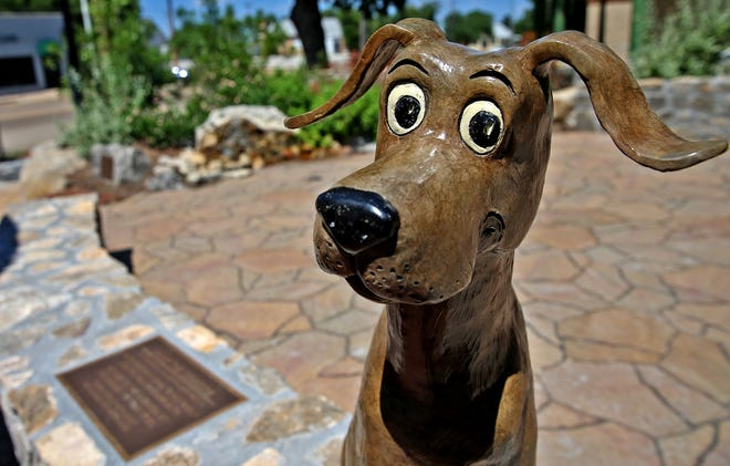 A small statue of Hank the Cowdog greets visitors to Heritage Park in downtown San Angelo in this July 18, 2019, photo.