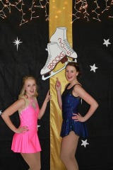 Brooke Thompson and Brooke Nattress pose in front of a skate figure sign with their name on it in 2015. The two figure skated together throughout grade school.