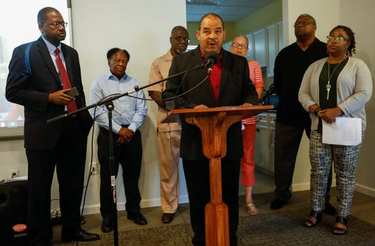 Mark Dixon, executive director of the Bartley-Decatur Neighborhood Center, speaks during the Community Education Coalition for Springfield Public Schools Equity's news conference on Wednesday, July 24, 2019, in Springfield, Mo. Also pictured are, from left, Samuel Knox, Calvin L. Allen, Bishop Jonas Foote, Cheryl Clay, Wes Pratt and Shurita Thomas-Tate.