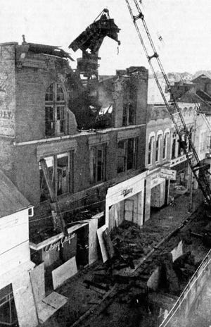 The third floor of 20 and 24 E. Beverley St., which housed Dunsmore Fashions and Chevy Chase women's shop, is demolished following a Jan. 13-14 fire that gutted the building.
