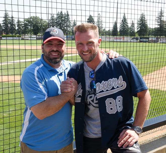 Rox manager Augie Rodriguez and Sascha Schubert pose for a picture at Joe Faber Field Wednesday, July 24, 2019. The two former teammates in Germany hadn't seen each other in 15 years before Schubert surprised Rodriguez at the July 20 Rox game.