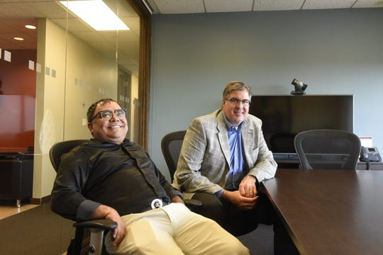 King Mukherjee (left) and Bob Gazich (right), co-founders of St. Cloud textile startup Global Impex, pose for a portrait at a co-working space in downtown St. Cloud on Monday, July 22, 2019.