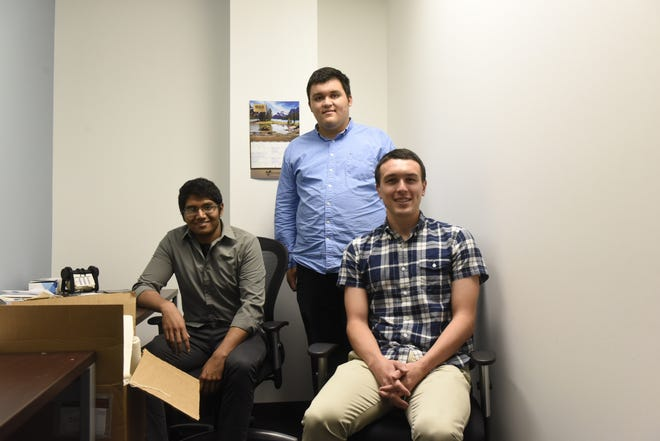 Current and former Global Impex interns (from left) Shadman Ahmed, Daniel Fabres and Michael Messner poise for a photo at a co-working space in downtown St. Cloud.