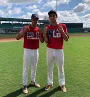 Next Level Baseball 18U players True Fontenot and Michael-Todd Reed celebrate after winning the 2019 Perfect Game 18U World Series.
