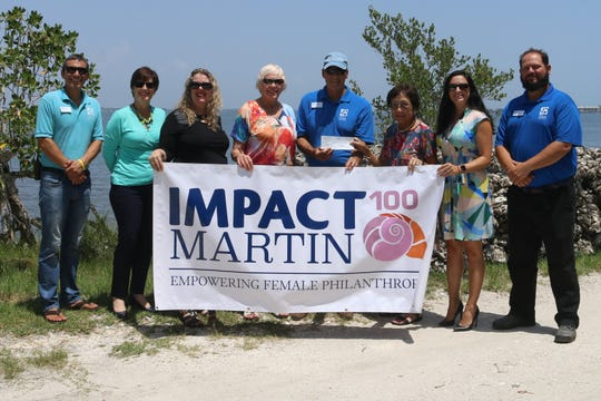 "Florida Oceanographic Society members of the Impact 100 Martin grant program and Florida Oceanographic Society staff, from left, Dr. Zack Jud, Betsy Johnson, Linda Weiksnar, Rita May Wright, Mark Perry, Nancy Wong, Genevieve ""Gen"" George, Dr. Glenn Coldren."