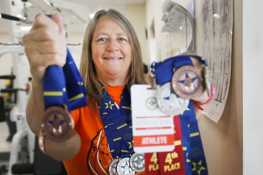Cathy Soto shows medals she has won competing in different Golden Age Games on Tuesday, July 23, 2019, at the VA Medical Center in El Paso.