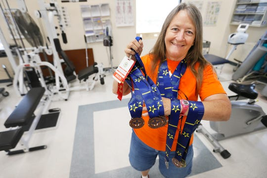 Cathy Soto has won many medals competing in different Golden Age Games. She shows some of them Tuesday, July 23, 2019, at the VA Medical Center in El Paso.