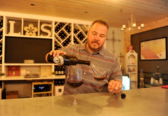 "Luigi Lucas, co-owner of Lucas Sellers Wine in Moorpark, pours a taste of 2016 Santa Ynez Valley-sourced grenache. The wine is also known as ""Berley,"" his nickname for wife Kimberley Lucas."