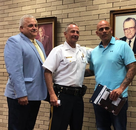 Vineland Police Officer Charles Capelli (right) is congratulated on his retirement  by Police Chief Rudy Beu (center) and Public Safety Director Edwin Alicea. July 23, 2019