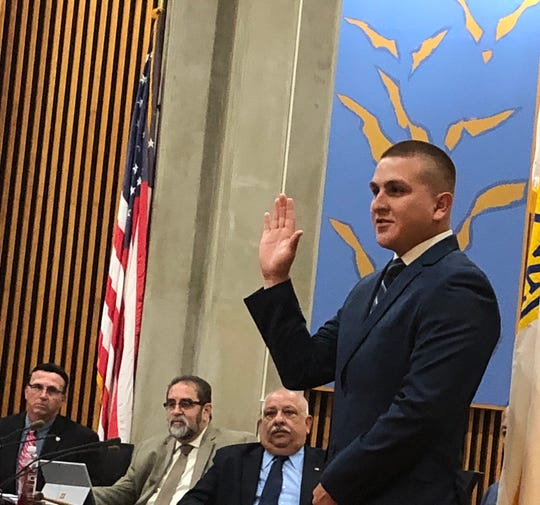 Nicholas Santiago takes his oath as he is sworn-in as a Vineland Police before City  Council. July 23, 2019