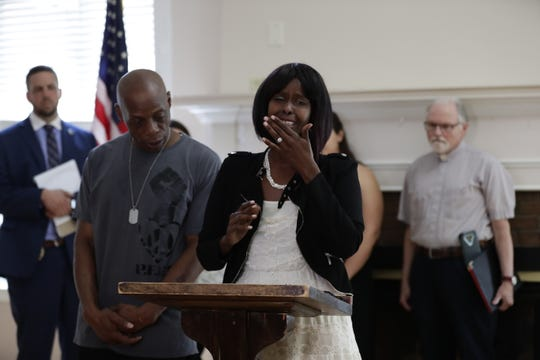 Sadia Hussein breaks into tears while explains about the incident she experienced during her press conference Wednesday, July 24, 2019, at the YWCA in Wausau, Wis. Next to her Hussein is Christopher Norfleet, Ceo/Founder of People For The Power of Love. T'xer Zhon Kha/USA TODAY NETWORK-Wisconsin