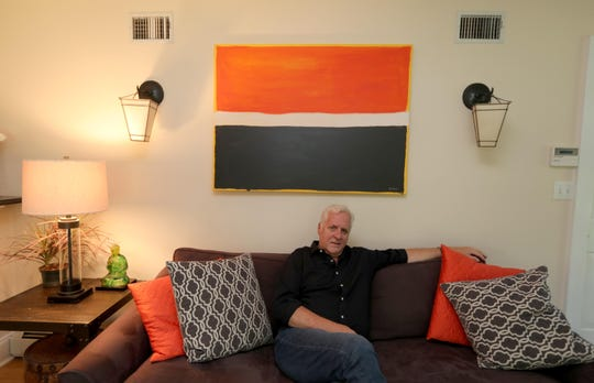 "Actor Bill Hoag sits under one of his own paintings at his home in Nanuet. Hoag has appeared on ""Orange is the New Black"" as Bill Chapman, Piper Chapman's father, since the shows beginning. The final season premieres on Netflix July 26. Hoag's acting career spans 40 years and includes work in theater, television and film."