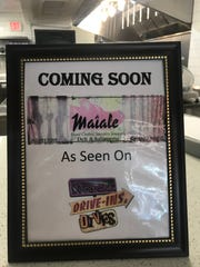 """A sign at the Pop-Up stand at the DECO food hall in downtown Wilmington announces that Maiale Deli & Salumeria is coming soon. The Wilmington eatery was recently showcased on the Food Network series """"Diners, Drive-ins and Dives."""""""