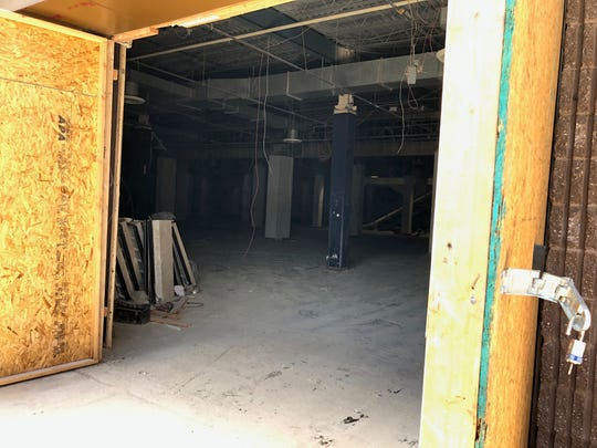 A look inside the former Sears building at the Prices Corner shopping center. Demolition inside the building began in June. Many of the walls are being removed so that engineers and designers can inspect and reimagine the space.