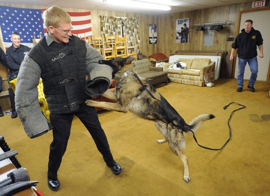 Andy DeWitt of the Wisconsin Rapids Police Department wears a bite suit as the dogs master Dean Fleisner, right, also of the police department in Wisconsin Rapids works with his new police K-9 dog named, Diego in 2008. The department announced Wednesday morning that Diego had died.