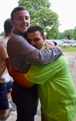 Judge Alex Costello of Compeer Financial gets a big hug from Seth Zimmerman following the Final Drive show.