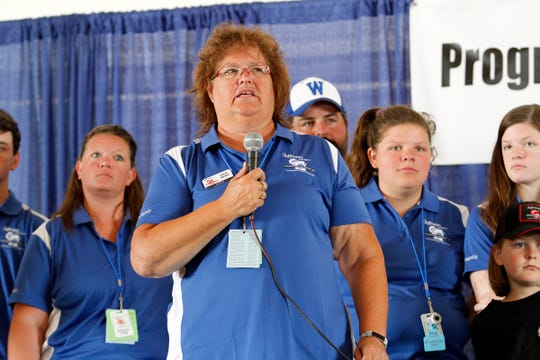 Sarah Walter introduces members of the Walter family and recognizes the hard work put into making Farm Technology Days possible during the opening ceremony on July 23, 2019.