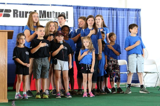 Grandchildren of Mike and Sarah Walter lead the Pledge of Allegiance during the opening ceremony at Jefferson County Farm Technology Days on July 23, 2019 in Johnson Creek.