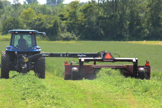Cutting second crop hay Fond du Lac County.