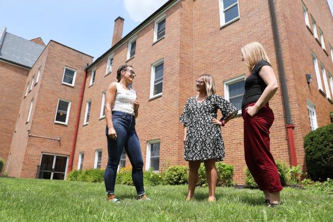 Constance Marling, left, Sara Blake and Tegan Drake talk outside College Drive Presbyterian Church in New Concord.