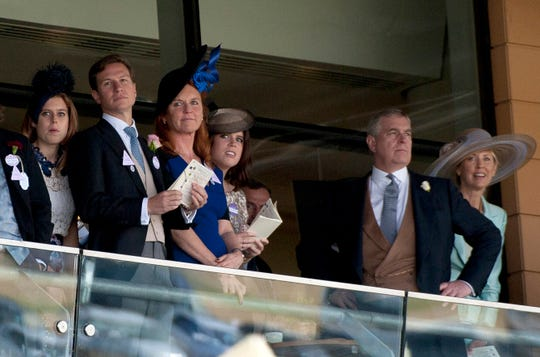 Prince Andrew, Duke of York (2-R) watches horse racing with Sarah Ferguson, Duchess of York (3-L), and daughters Princess Beatrice of York (L), and Princess Eugenie of York (3-R) at Royal Ascot June 19, 2015.