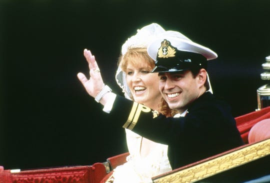 Prince Andrew the Duke of York and his bride Sarah Ferguson, Duchess of York, ride in the 1802 State Landau carriage in a ceremonial procession to London's Buckingham Palace after their marriage at Westminster Abbey, July 23, 1986.