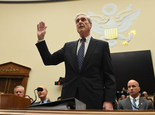 Former Special Prosecutor Robert Mueller is sworn in for his testimony before Congress on July 24, 2019, in Washington, DC. - Mueller is expected to testify about his two-year report on his investigation of Russian meddling in the 2016 elections.