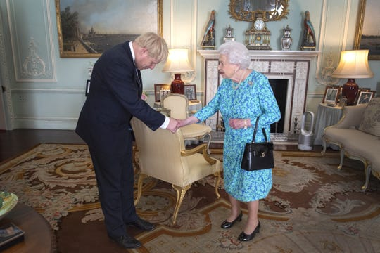 Queen Elizabeth II welcomes newly elected leader of the Conservative Party, Boris Johnson during an audience where she invited him to become Prime Minister and form a new government, at Buckingham Palace on July 24, 2019.