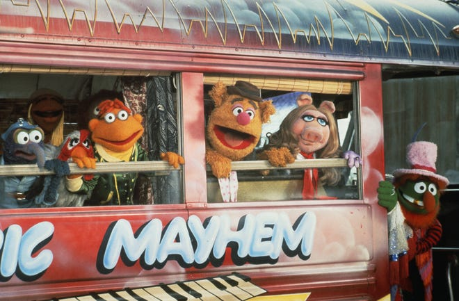 """Gonzo (from left), Camilla, Scooter, Fozzie Bear, Miss Piggy and Dr. Teeth climb aboard the Electric Mayhem Bus in """"The Muppet Movie."""""""