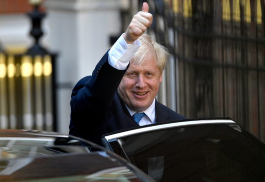 Boris Johnson leaves Conservative Party headquarters after being announced as Britain's new leader in London on July 23. 2019.