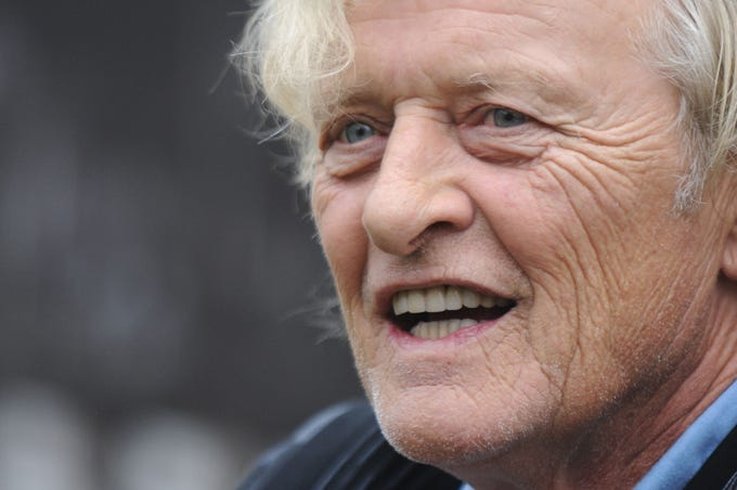 """Rutger Hauer, American movie actor, died on July 19, 2019. His most most notable role came in """"Blade Runner,"""" where he co-stared with Harrison Ford. Click forward to view his career in pictures."""