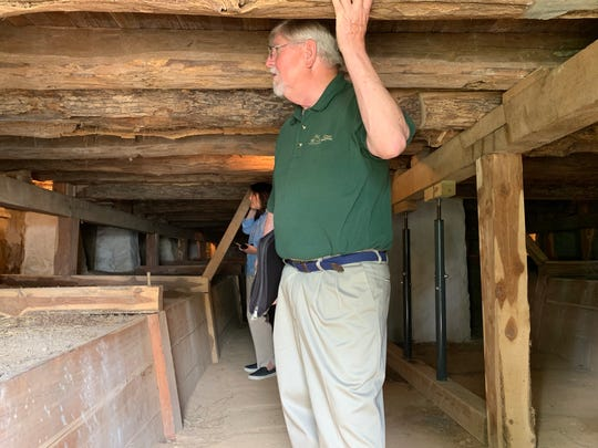 Bob Mueller, front, and Sandra Cabot, inspect the 200-year-old foundation of the Amoureux House, part of the soon-to-be-established Ste. Geneviève National Historical Park.