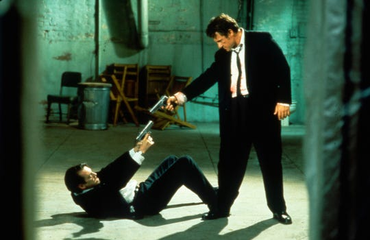 "Mr. Pink (Steve Buscemi, left) and Mr. White (Harvey Keitel) share a tense moment in ""Reservoir Dogs."""