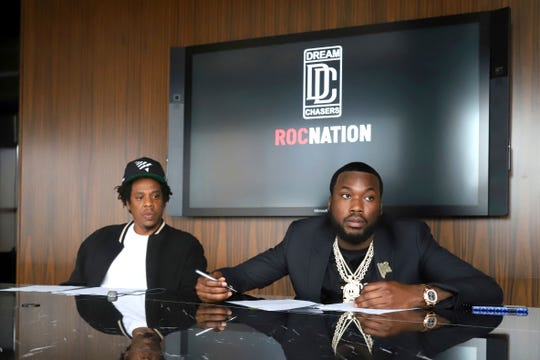 Jay-Z, left, and Meek Mill make an announcement of the launch of Dream Chasers record label in joint venture with Roc Nation, at the Roc Nation headquarters on Tuesday, July 23, 2019, in New York.