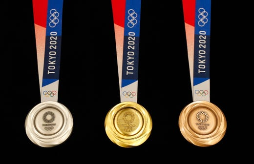 The silver, gold and bronze medals for the 2020 Summer Olympics. The front side carries the Tokyo Olympic emblem, with the Greek goddess of victory on the back.