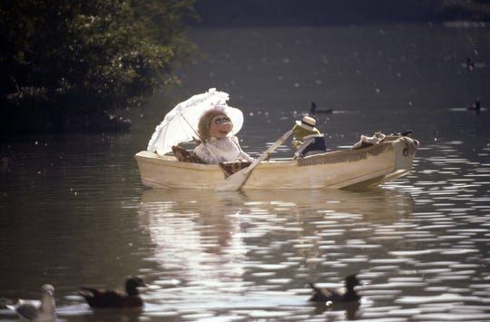 """Miss Piggy and Kermit the Frog go on a tuneful boat ride in """"The Muppet Movie."""""""