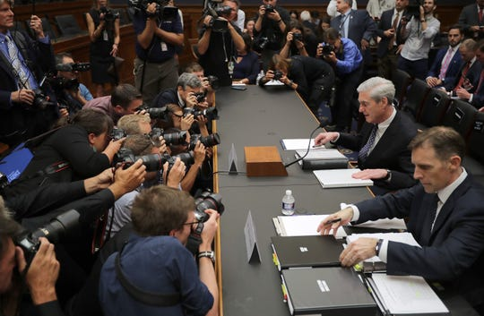 Former Special Counsel Robert Mueller, left, and former Deputy Special Counsel Aaron Zebley arrive to testify before the House Intelligence Committee.